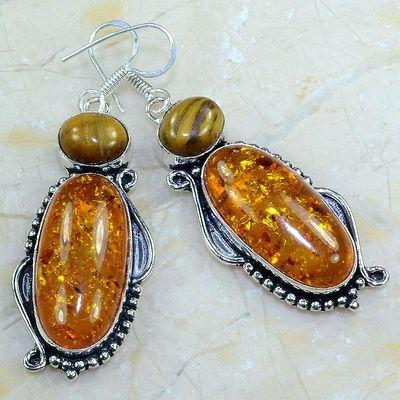Amb 018a boucles pendants oreilles ambre oeil de tigre amber baltique achat vente bijoux argent 925