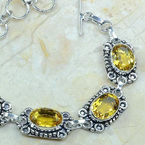 CT-0051 - Joli BRACELET 20 cm en argent 925 avec 5 CITRINES dorées - 126,5 carats - 25,3 gr