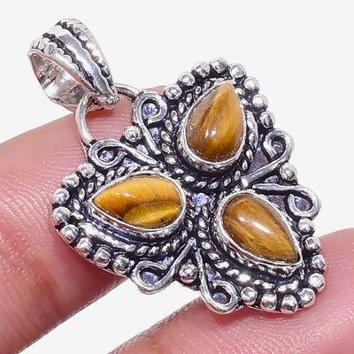 Ot 1025a pendentif pendant triskel 6gr 6x8mm oeil de tigre argent 925 achat vente bijoux 1 1