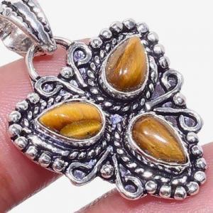 Ot 1025c pendentif pendant triskel 6gr 6x8mm oeil de tigre argent 925 achat vente bijoux 1 1