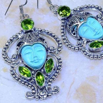 Per 388c boucles oreilles peridot bouddha gothique argent 925 achat vente bijou