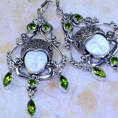 Per 389c boucles oreilles peridot bouddha gothique argent 925 achat vente bijou