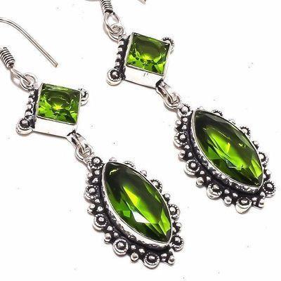 Per 657c boucles pendants oreilles peridot 10x20mm 14gr achat vente bijou argent 925