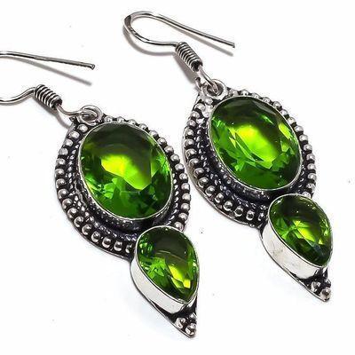 Per 663c boucles pendants oreilles peridot 10x18mm 13gr achat vente bijou argent 925