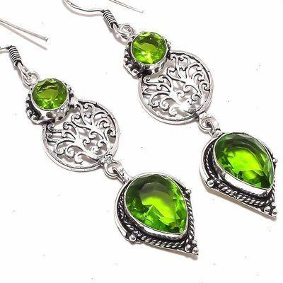 Per 664c boucles pendants oreilles peridot 12x18mm 14gr achat vente bijou argent 925
