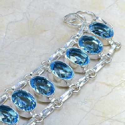 TPZ-037 - Superbe BRACELET avec 10 TOPAZES Bleu Suisse et argent 925 - 20 cm - 162 carats 32,4 gr