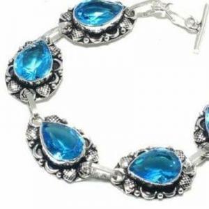 Tpz 697b bracelet 28gr topaze bleu suisse 15x10mm ethnique baroque bijou argent 925 vente achat