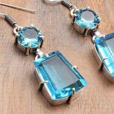 Tpz 739c boucles oreilles pendants 15gr 20x15mm paire topaze bleu suisse argent 925 vente achat