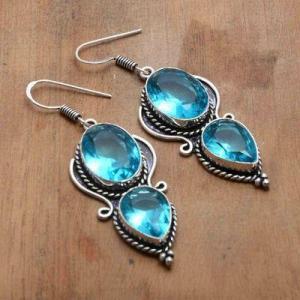 Tpz 740a boucles oreilles pendants 12gr 12x16mm paire topaze bleu suisse argent 925 vente achat