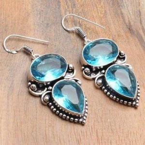 Tpz 741a boucles oreilles pendants 17gr 12x16mm paire topaze bleu suisse argent 925 vente achat