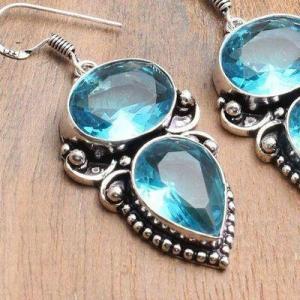 Tpz 741c boucles oreilles pendants 17gr 12x16mm paire topaze bleu suisse argent 925 vente achat