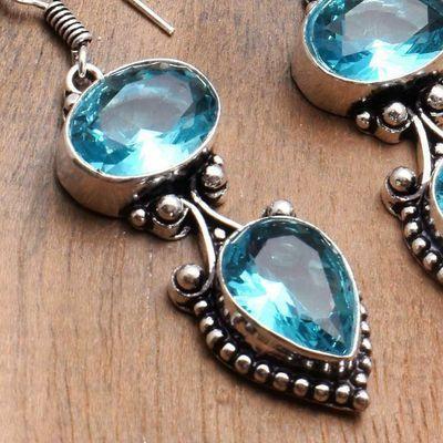 Tpz 743c boucles oreilles pendants 13gr 10x12mm paire topaze bleu suisse argent 925 vente achat
