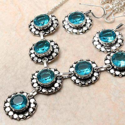 Tpz 761b collier boucles oreilles 31gr 10x15mm topaze bleu suisse argent 925 vente