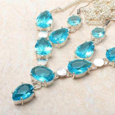 Tpz 762b collier boucles oreilles 24gr 10x15mm topaze bleu suisse argent 925 vente