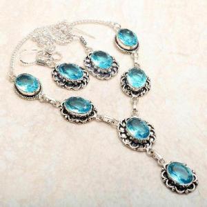Tpz 764a collier boucles oreilles 31gr 10x15mm topaze bleu suisse argent 925 vente