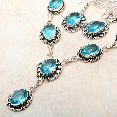 Tpz 764c collier boucles oreilles 31gr 10x15mm topaze bleu suisse argent 925 vente
