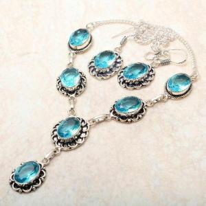 Tpz 764d collier boucles oreilles 31gr 10x15mm topaze bleu suisse argent 925 vente