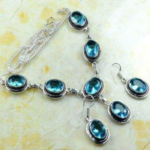 Tpz 767a collier boucles oreilles 34gr 10x15mm topaze bleu suisse argent 925 vente