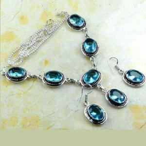 Tpz 767d collier boucles oreilles 34gr 10x15mm topaze bleu suisse argent 925 vente